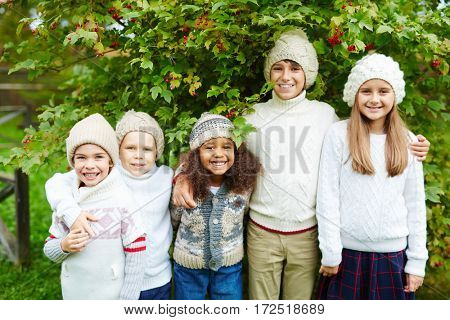 Friendly kids under guelder tree