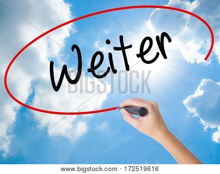 Woman Hand Writing Weiter (continue In German)  With Black Marker On Visual Screen