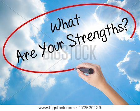 Woman Hand Writing What Are Your Strengths? With Black Marker On Visual Screen