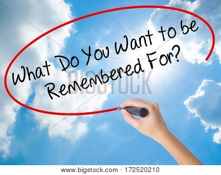 Woman Hand Writing What Do You Want To Be Remembered For? With Black Marker On Visual Screen