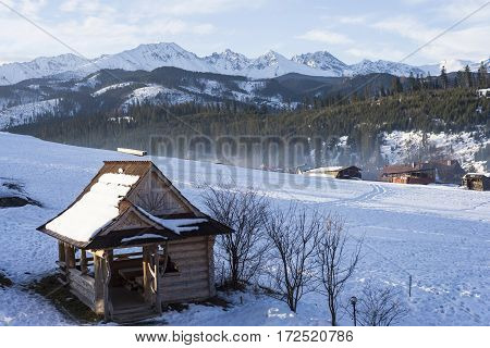 Winter mountains covered with snow view from a big meadow in Tatry mountains in Poland