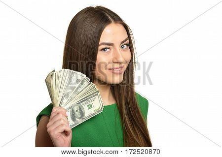 Beautiful woman in green dress with money on white background