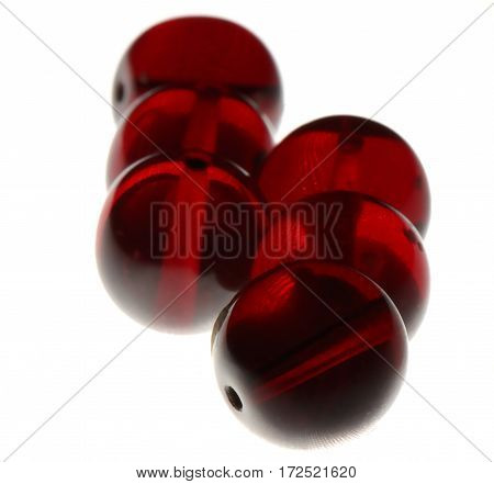 Several red beads isolated on white background