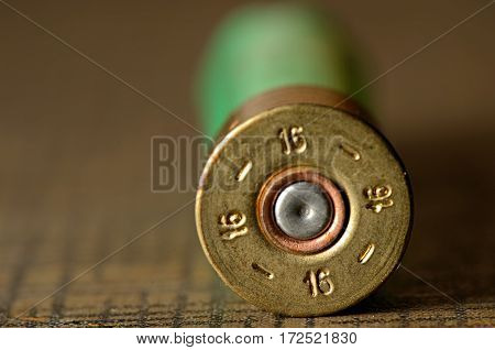 hunting cartridges for shotgun 16 caliber isolated on wooden background