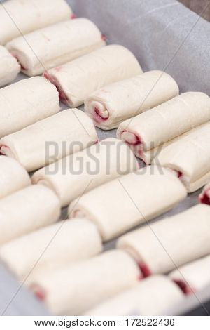 Raw Puff Pastry Stuffed With Cherry Cream On The Baking Tray
