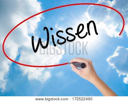 Woman Hand Writing Wissen (know In German)  With Black Marker On Visual Screen