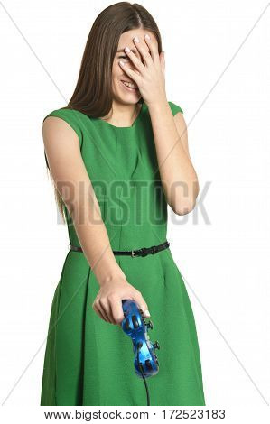 Portrait of beautiful woman with gamepad on white background