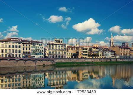 Embankment of the Arno River near Ponte Vecchio and Uffizi Gallery, Florence, Italy. Travel outdoor sightseeing background.