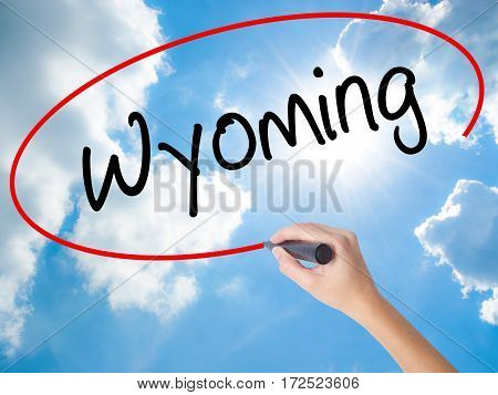 Woman Hand Writing Wyoming  With Black Marker On Visual Screen