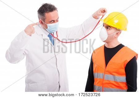 Doctor Checking Constructors Helmet With Stethoscope