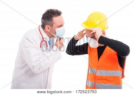 Male Doctor Looking At Constructor Head Pain Injury
