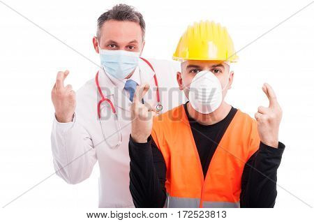 Doctor And Constructor Showing Fingers Crossed Gesture
