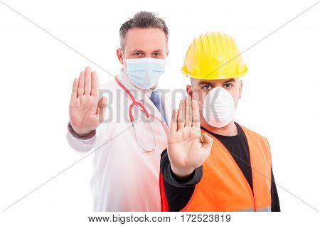 Doctor And Constructor Showing Stop Gesture With Hands