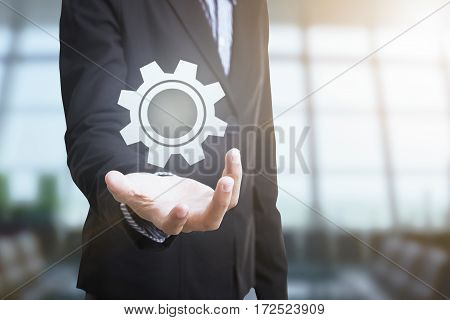 Businessman with gear system icon. concept technology innovation strategy.
