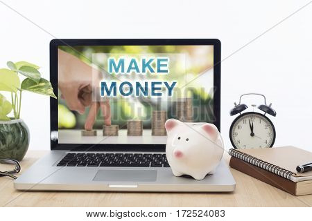 Make money homepage on the computer screen in workplace. business financial concept.