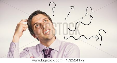 Close-up of thoughtful businessman looking up against grey background