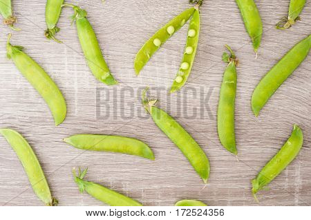 Pods of peas on a wooden background. Broad beans of peas background. Selective focus