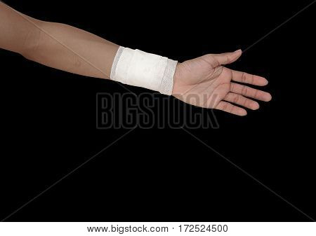 gauze bandage patient with hand wrap injury isolated on black background and clipping path