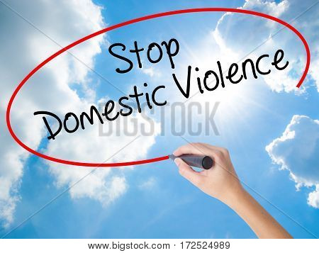 Woman Hand Writing  Stop Domestic Violence With Black Marker On Visual Screen