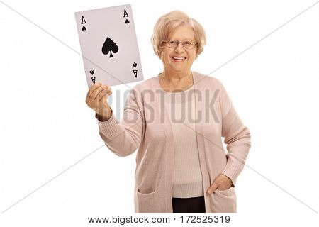 Happy mature woman showing an ace of spades card isolated on white background