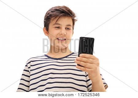 Boy looking at a phone and smiling isolated on white background