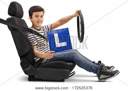 Boy sitting in a car seat and showing an L-sign isolated on white background