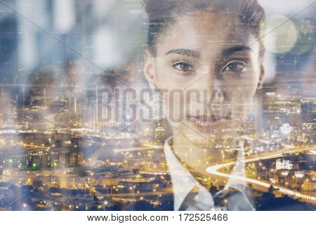 Close-up portrait of pretty businesswoman in office