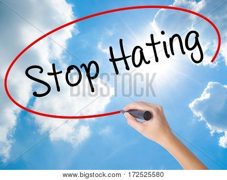Woman Hand Writing Stop Hating  With Black Marker On Visual Screen