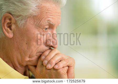 Portrait of a pensive senior man looking at distance