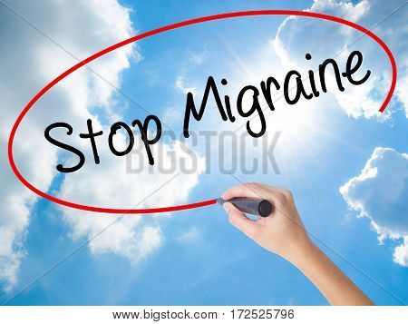 Woman Hand Writing Stop Migraine  With Black Marker On Visual Screen