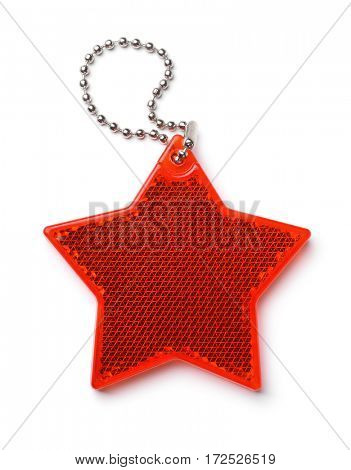 Top view of red star safety reflector isolated on white