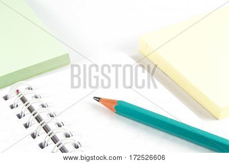 Office supplies - Graphite pencil on white notebook and color note paper