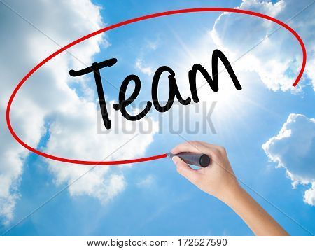 Woman Hand Writing Team With Black Marker On Visual Screen