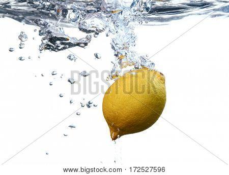Splashing lemon into fresh water on white background