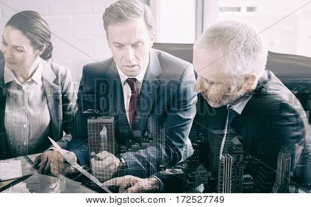 Business people interacting in conference room during meeting at office