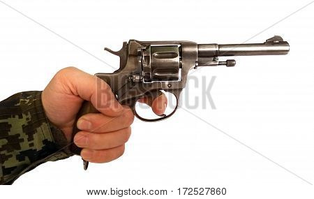 Old revolver in his left male hand which finger on the trigger before firing the shot