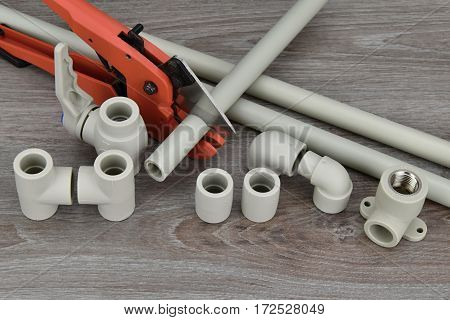 Components making water pipes and special scissors for cutting plastic water pipes.
