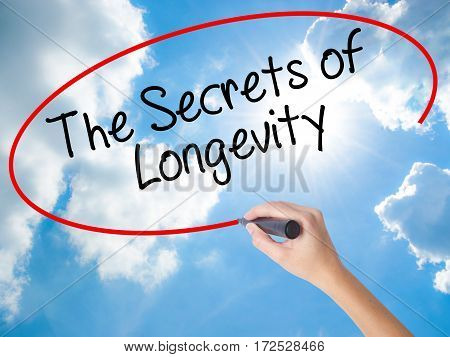 Woman Hand Writing The Secrets Of Longevity With Black Marker On Visual Screen