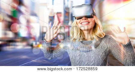 Cheerful young woman using reality virtual headset against blurry new york street
