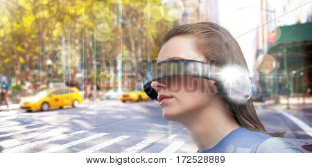Low angle view of woman trying virtual reality against blurry new york street