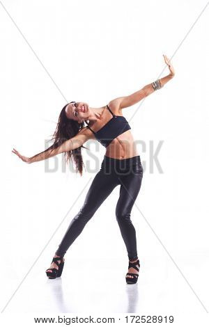 Stylish and young modern style dancer jumping