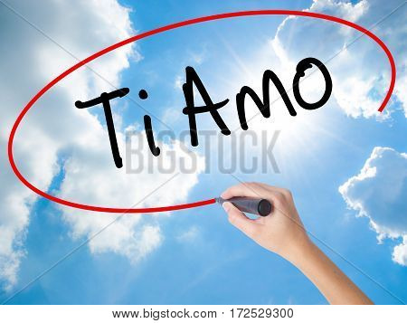 Woman Hand Writing Ti Amo (i Love You In Italian) With Black Marker On Visual Screen.