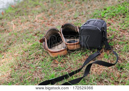 bag black and brown shoes leather old on grass