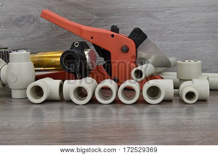 Plastic pipe welder. Components making water pipes and special scissors for cutting plastic water pipes.