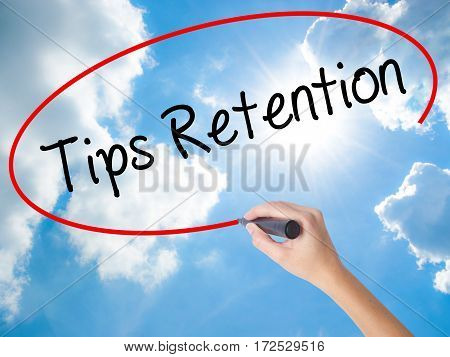 Woman Hand Writing Tips Retention With Black Marker On Visual Screen.