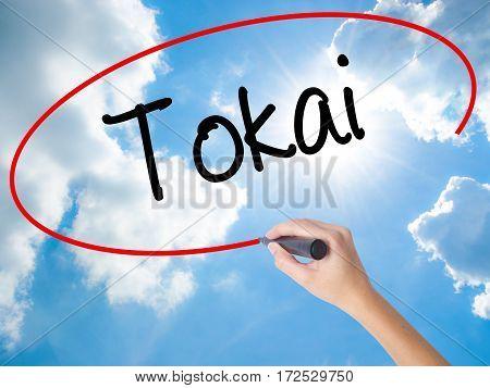 Woman Hand Writing Tokai With Black Marker On Visual Screen