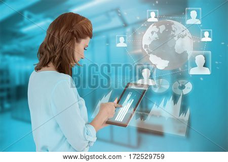 Businesswoman using tablet over blue background against image of data storage