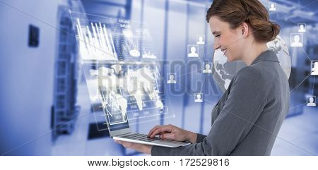 Side view of businesswoman using laptop computer against image of data storage 3d