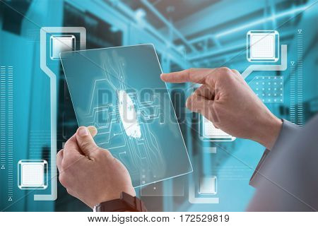 Businessman touching an glass sheet against blue vignette background