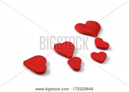 Many red silk hearts - valentine on white background